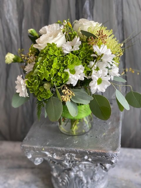 White and green vase arragement